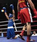 图文-20日奥运赛场拳击赛况 庆祝胜利