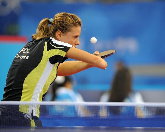 图文-奥运乒乓赛场上的维纳斯 专注比赛的神情依旧