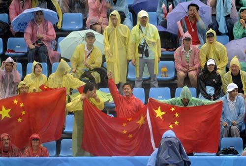 图文-奥运会沙排经典瞬间回顾 大雨挡不住热情