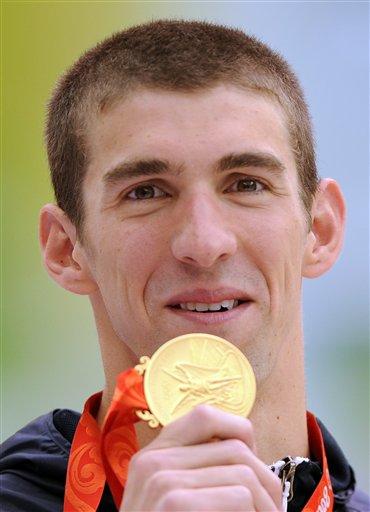 图文-男子100米蝶菲尔普斯夺冠 无比激动