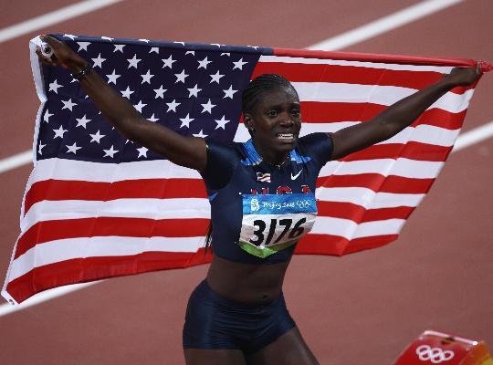 图文-奥运女子100米栏决赛赛况 展示冠军风采