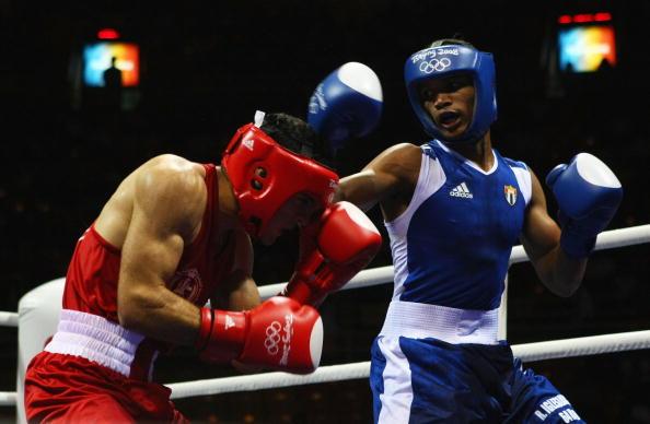 图文-14日奥运会拳击比赛赛况 双方陷入苦战