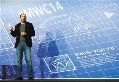 """2014年2月24日,全球电信行业最大规模的盛会""""世界移动通信大会2014""""在西班牙巴塞罗那开幕,库姆在大会上发言。"""