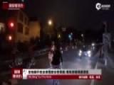 实拍骑行抗议者围攻女性司机 举车狂砸场面混乱