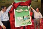 """环境保护部部长周生贤和中国邮政集团公司总经理刘安东共同为""""低碳减排 绿色生活""""系列邮品揭幕"""