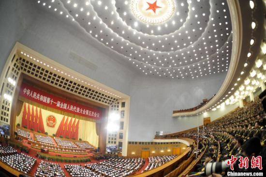 3月5日9时,第十一届全国人民代表大会第五次会议在北京人民大会堂开幕,听取国务院总理温家宝作政府工作报告,审查年度计划报告和预算报告。中新社记者 廖攀 摄
