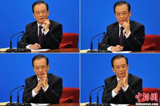 3月14日,国务院总理温家宝在人民大会堂三楼金色大厅与中外记者见面并回答提问。中新网记者 金硕 摄