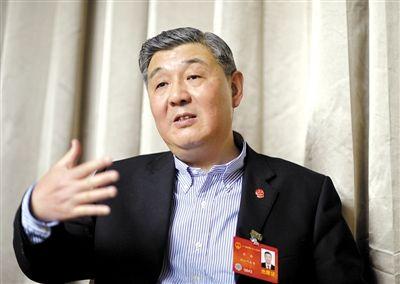 今年全国两会期间,全国人大代表、浙江高院院长齐奇接受记者采访。新京报记者 陈杰 摄