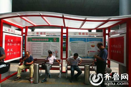 南长途汽车总站建室外吸烟区设遮阳棚座椅垃大阪店情趣用品图片