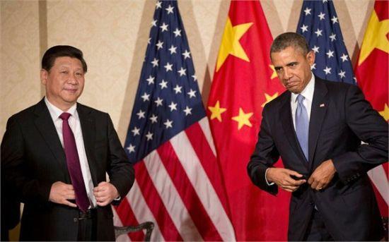 TPP谈判将搭便车在北京召开,但亚太自贸区谈判是否能成功举行目前还是个未知数。图为今年3月,国家主席习近平和美国总统奥巴马在荷兰阿姆斯特丹会面。