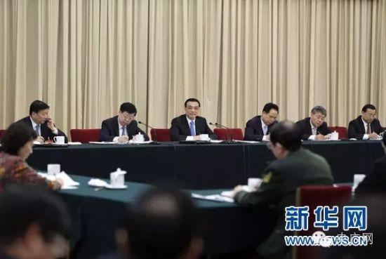 3月6日,中共中央政治局常委、国务院总理李克强参加十二届全国人大三次会议山东代表团的审议。新华社记者 丁林 摄