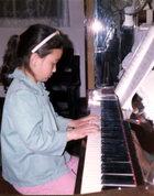 8岁开始弹钢琴