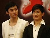 徐亮与谢孟伟(右)