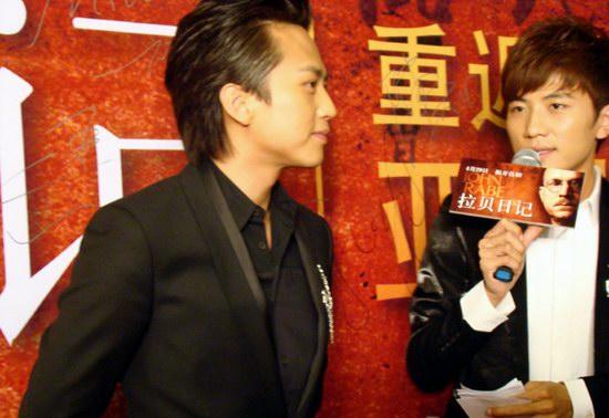 组图:《拉贝日记》首映获好评邓超新发型耀眼