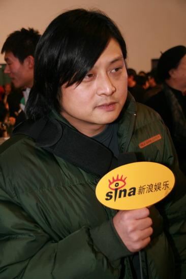 图文:《集结号》首映导演张杨表情依旧严肃
