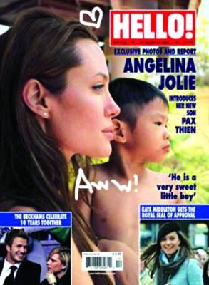 安吉丽娜-朱莉:从叛逆少女到博爱母亲(组图)(4)