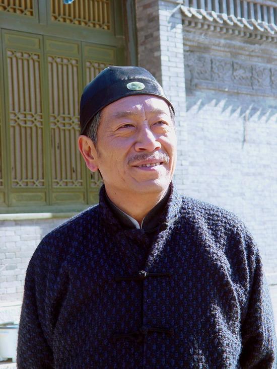 周掌柜扮演者王奎荣