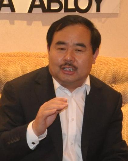 国强五金总经理 李敬芳保证企业发展是最大的正能量