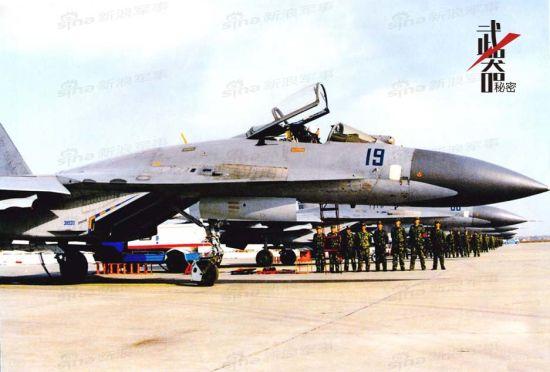 """资料图:""""深蓝19号""""是一架典型的空3师原装苏-27SK。进气道侧面的38920代码代表着它是第38批第20架苏-27生产型(中间的9是随机数字,无具体意义),也是这一批次的最后一架。空3师进口的苏-27SK为共青城厂第38批03架至20架,以及第39批01架和02架。"""
