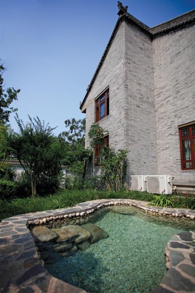 西安院子设计元素以中国传统庭院为基调,兼顾北方民居,采用了门楼图片