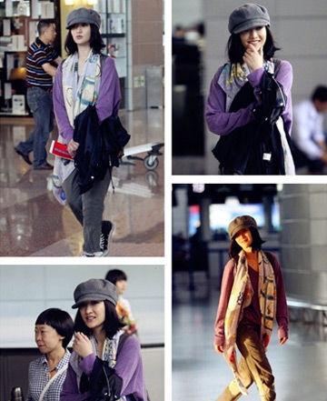 周迅穿着抢眼的紫色上衣