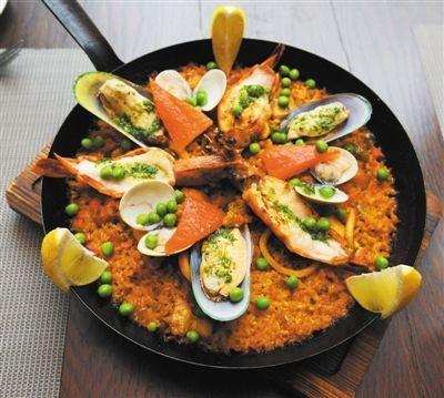 """海鲜饭可谓西班牙的""""国饭"""",几乎所有西班牙餐厅里都有。"""