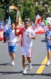 图文-奥运圣火继续在天津传递 火炬手刘术岭在传递