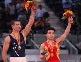 图文-世界杯总决赛中国两金收官双杠项目并列冠军